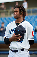 Lake County Captains right fielder Oscar Gonzalez (39) stands for the national anthem before the first game of a doubleheader against the South Bend Cubs on May 16, 2018 at Classic Park in Eastlake, Ohio.  South Bend defeated Lake County 6-4 in twelve innings.  (Mike Janes/Four Seam Images)