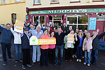 21-9-2017:  Mary Murphy, Post Mistress, Rerrin Post Office on Bere Island in County Cork with family, friends and customers and Fran Whearty, Communications Executive, The National Lottery after she sold a 500,000 Euro Millions Plus ticket pictured celebrating on Thursday.<br /> Photo: Don MacMonagle<br /> <br /> Issued on behlf of The National Lottery