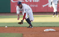 NWA Democrat-Gazette/J.T. WAMPLER  Shortstop Ramon Torres scoops up a hit Thursday Aug. 13, 2015 during the Naturals game against the San Antonio Missions at Arvest Ballpark in Springdale.