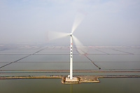 A wind turbine near Dashentang, in Hebei Province. This stretch of coastline has been highlighted as one of the most vulnerable in China and will be one of the first to feel the impacts of rising sea levels and increased storm surges. China, 2019.