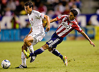 Chivas USA defender Mariano Trujillo moves in on DC United defender Jed Zayner. CD Chivas USA beat DC United 1-0 at Home Depot Center stadium in Carson, California on Sunday August 29, 2010.
