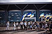 Kharkov 28.08.2010 Ukraine.<br /> People waiting on the first flight of the new terminal in Kharkov, a day later, the airport will be closed.<br /> On picture: supporters of Ukrainian President Viktor Yanukovych.<br /> Kharkov prepares for the UEFA European Football Championships EURO 2012. Many problems affecting the city, lack of maintenance, lack of hotel accommodation and also problems with electricity. Stadium Metalist Kharkiv - One of the main four of Ukrainian stadiums of Euro 2012 is not modernized. Playmaker club matches at the stadium is Metalist Kharkiv.<br /> Photo: Adam Lach / Napo Images<br /> <br /> Ludzie czekaja na pierwszy lot z nowego terminalu w Charkowie, dzien pozniej lotnisko zostanie zamkniete. Na zdjeciu zwolennicy ukrainskiego prezydenta Wiktora Janukowycza.<br /> Charkow przygotowuje sie do Mistrzostw Europy w Pilce noznej Euro 2012. Wiele problemow dotyka miasto, brak remontow, brak bazy hotelowej a ponadto problemy z elektrycznoscia.  Stadion Metalist w Charkowie - Jeden z czterech podstawowych Ukrainskich stadionow zwiazanych z Euro 2012 nie jest modernizowany. Klubem rozgrywajacym mecze na tym stadionie jest Metalist Charkow.<br /> Fot: Adam Lach / Napo Images