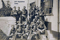 BNPS.co.uk (01202 558833)<br /> Pic: SuzanneHolwell/BNPS<br /> <br /> 247 Sqn on the steps of the pub. <br /> <br /> Flight crew at the pub and, rear, sections of their ties which were snipped off and pinned to the wall by barmaid Ailsa Lobb. <br /> <br /> Sections of a torn-down pub ceiling which are covered in 250 signatures from World War Two heroes have been salvaged and turned into a memorial.<br /> <br /> The merry airmen left their mark during raucous evenings at the George and Dragon in the village of Clyst St George in Devon.<br /> <br /> Many of the brave men who signed or drew on the wood ceiling perished in the war in the skies with the Luftwaffe.<br /> <br /> One of them, Sergeant Albert Stilin, of 257 Squadron, was killed aged 21 when he crashed his Hurricane into this pub's roof on September 30, 1942. Another airman later put the initials 'RIP' put after his name.<br /> <br /> The ceiling was taken down in 1975 and half of it was destroyed. <br /> <br /> Robin and Suzannah Holwell recovered the surviving planks from a RAFA association store room in 2009 and have carried out a decade-long preservation project, putting the sections in frames and researching the men behind signatures.
