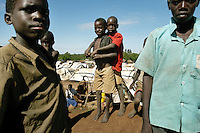 Alayo, Sormon, 8, left-center and Awio Jackson, 7 remained friends after meeting in Barlonyo camp for internally displaced people in November 2003. When The camp was attacked by the Lord's Resistance Army in February of 2004, Jackson's mom grabbed him and ran. The two boys eneded up with their mothers together in another IDP camp set up in Lira town on the grounds Lira Primary 7 school .