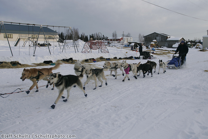 Jerry Sousa leaves on Wednesday morning from the Nikolai checkpoint.  2005 Iditarod Trail Sled Dog Race.