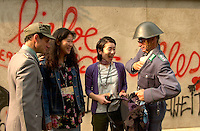 Two fake VOPO's (the infamous East German soldiers)search the bag of Yuki Imamura (M-L) and Mayumi Shinada (M-R) who both work for AlcinÈ TÈrrran ;  the Japanese distributors for the movie The Tunnel,  beside a recreation of the Berlin Wall outside   the Imperial Cinema  in Montreal, CANADA,  <br /> Where the Movie `` The Tunnel `` (Der Tunnel) is beeing shown in the World Film Festival Competition, August 31, 2001<br /> <br /> The movie directed by Roland Suso Richter tell the story of East-Germans who dug a tunnel uner the Berlin Wall.<br /> <br /> Photo by Pierre Roussel /Getty News Images Service (ON SPEC)<br /> <br /> NOTE : raw jpeg from Nikon D 1, openened with QUIMAGE ICC profile