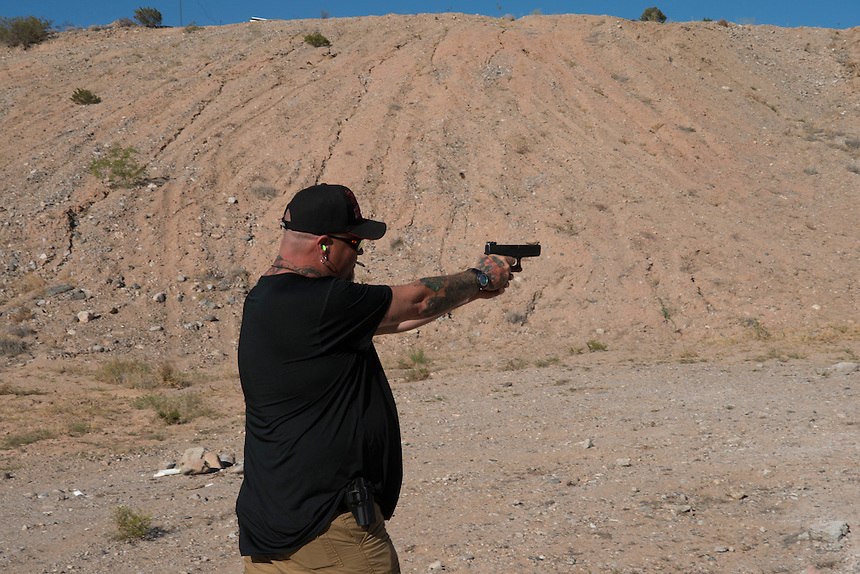 A militia member who serves as Cliven Bundy's personal bodyguard practices with his sidearm at camp &quot;Liberty&quot; near the Cliven Bundy ranch in Bunkerville, Nevada.<br /> <br /> <br /> Supporters of Bundy came from all over the country to defend against what they believe is government overreach.<br /> The Bundy standoff is a 20-year legal dispute between the United States Bureau of Land Management (BLM) and cattle rancher Cliven Bundy, over unpaid grazing fees, that recently provoked an armed confrontation between protesters and law enforcement.