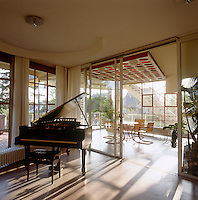 "The grand piano is one of the original pieces of furniture which was returned to Haus Schminke during its restoration and the chairs in the winter garden are the ""D42"" cantilevered design by Mies van der Rohe"