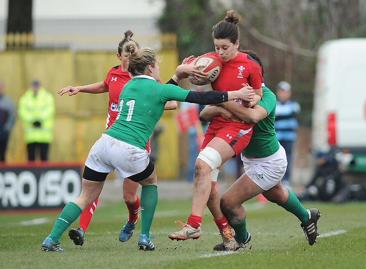 Wales&rsquo; Sioned Harries is tackled by Ireland&rsquo;s Sophie Spence <br /> <br /> Photographer Kevin Barnes/CameraSport<br /> <br /> International Womens Rugby Union - 2015 Women&rsquo;s RBS Six Nations - Wales Women v Ireland Women - Sunday 15th March 2015 - St Helen's - Swansea<br /> <br /> &copy; CameraSport - 43 Linden Ave. Countesthorpe. Leicester. England. LE8 5PG - Tel: +44 (0) 116 277 4147 - admin@camerasport.com - www.camerasport.com