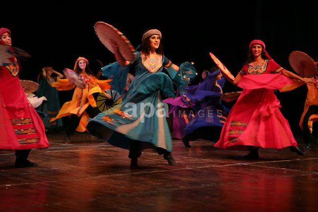 Dancers of the El-Funoun Palestinian Popular Dance Troupe perform during a concert as part of the Palestinian Heritage Festival in the West Bank city of Ramallah on October 29, 2010 . Photo by Eyad Jadallah