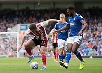 Lynden Gooch of Sunderland under pressure from Janoi Donacien of Ipswich Town during Ipswich Town vs Sunderland AFC, Sky Bet EFL League 1 Football at Portman Road on 10th August 2019