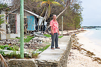 Siliga Kofe, head chief of Funafuti, stands on the seawall he built outside his home. Located in the South West Pacific Ocean, Tuvalu is the world's 4th smallest country and is one of the most vulnerable to climate change impacts including sea level rise, drought and extreme weather events. Tuvalu - March, 2019.