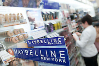An employee works on a Maybelline display at a Jean Coutu Pharmacy in Quebec city March 4, 2009.