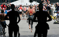 30 JUN 2007 - COPENHAGEN, DEN - Michelle Dillon (GBR) enters T1 after the swim - European Triathlon Championships. (PHOTO (C) NIGEL FARROW)