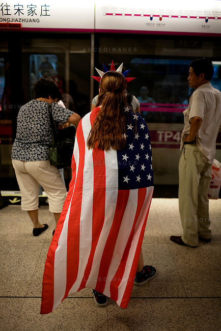 Megan Sisson, 23, of Tampa, Florida, shows her support for the American Olympic gymnastics team while waiting for the subway in Beijing, China on Wednesday, August 13, 2008.  Kevin German