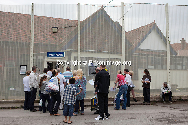 Visitors queuing at the main gate. HMP Styal, Wilmslow, Cheshire