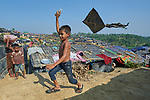 A Rohingya boy flies a kite in the Jamtoli Refugee Camp near Cox's Bazar, Bangladesh, where members of the ACT Alliance provide humanitarian support for the refugees. <br /> <br /> More than 600,000 Rohingya have fled government-sanctioned violence in Myanmar for safety in Bangladesh.
