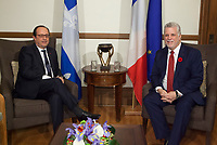 French President Francois Hollande and Quebec Premier Philippe Couillard talk at the Premier's office in Quebec City, Monday November 3, 2014. Hollande is on day two of a three day trip to Canada.<br /> <br /> PHOTO :  Francis Vachon - Agence Quebec Presse