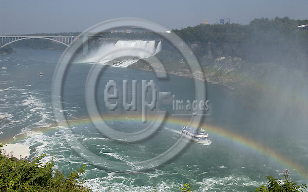 Niagara Falls, Ontario, Canada - 01 August 2006---Rainbow on the Niagara River with the American Falls, on the United States' side, and the Rainbow (International) Bridge---nature, landscape, infrastructure---Photo: Horst Wagner / eup-images