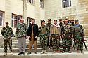 Iraq 2015<br />November in Sinjar, after the liberation of the city by the Kurdish forces, Yezidi peshmergas with 2 newcomers still without uniforms<br />Irak 2015 <br />Novembre a Sinjar, les nouveaux arrivants sans uniformes avec les peshmergas. Tous sont Yezidis.