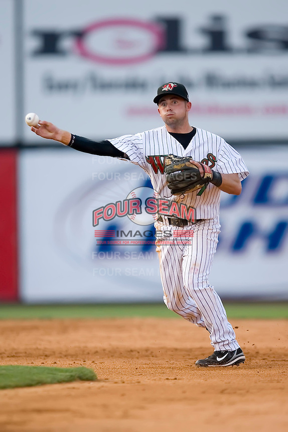 Shortstop C.J. Lang (7) of the Winston-Salem Warthogs makes a throw to first base at Ernie Shore Field in Winston-Salem, NC, Saturday, June 7, 2008.