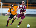Arbroath's Euan Smith gets away from Alloa's Darryl Meggatt.