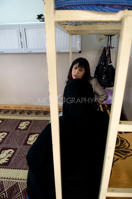 SULAIMANIA, IRAQ: Meeting with a new client, Rezan hears the story of a woman trafficked for prostitution from Baghdad into Sulaiymani.  Many Arab and also Kurdish women are trafficked from poor families in central and southern Iraq to the more prosperous Kurdistan Region..