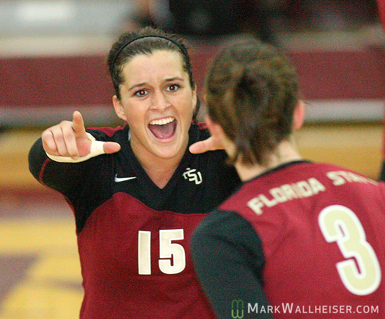 Seminole volleyball player Malorie Wessel, left, celebrates with teammate Lauren Richardson's score in game two against Wake Forest at Tully Gym in Tallahassee September 30, 2007.  The Seminoles won game two 30-25 but had to go to game five to defeat Wake Forest three games to two.  (Mark Wallheiser/TallahasseeStock.com)