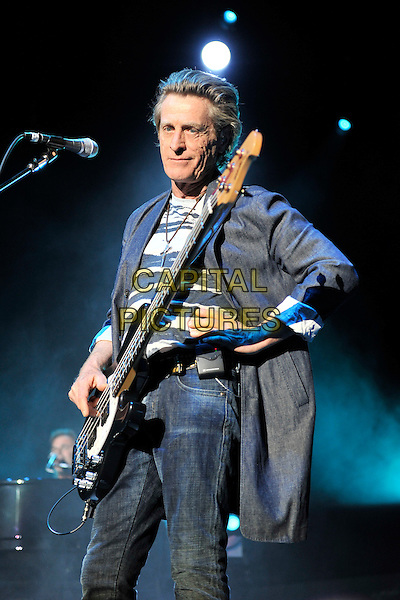 Journey - Ross Valory  .Journey performing live at Wembley Arena, London, England..June 4th, 2011.bang group stage concert live gig performance music half length black guitar grey gray top t-shirt bass jacket blue hand on hip.CAP/MAR.© Martin Harris/Capital Pictures.