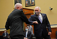 United States House Minority Whip Steve Scalise (Republican of Louisiana), elbow bumps Admiral Brett Giroir, US Assistant Secretary for Health, before testimony begins at a House Subcommittee on the Coronavirus Crisis hearing on a national plan to contain the COVID-19 pandemic, on Capitol Hill in Washington, DC on Friday, July 31, 2020. <br /> Credit: Kevin Dietsch / Pool via CNP /MediaPunch