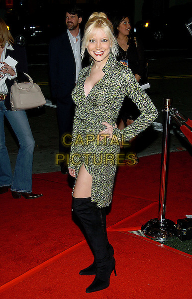 "COURTNEY PELDON.""Flight Of the Phoenix"" Screening held at the Mann Bruin Theater. .15 December 2004.full length, hand on hip, black thigh high boots, green wrap around dress.www.capitalpictures.com.sales@capitalpictures.com.© Capital Pictures."