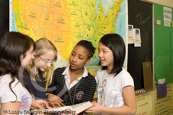 Public Middle School Grade 7 group of female students working together humanities social studies class horizontal