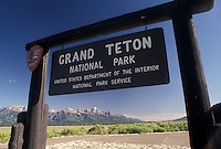 Grand Teton National Park, WY, Wyoming, Entrance sign to Grand Teton Nat'l Park and the picturesque Grand Teton Mountains in Wyoming.