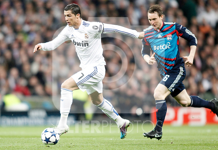 Real Madrid's Cristiano Ronaldo against Olympique de Lyon's Kim Kallstrom during Champions League match. March 16, 2011. (ALTERPHOTOS/Alvaro Hernandez)