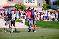 Jon Rahm (ESP) on the 18th green celebrating after winning  the DP World Tour Championship and race to Dubai with his caddy at the Jumeirah Golf Estates, Dubai, United Arab Emirates. 24/11/2019<br /> Picture: Golffile | Fran Caffrey<br /> <br /> <br /> All photo usage must carry mandatory copyright credit (© Golffile | Fran Caffrey)