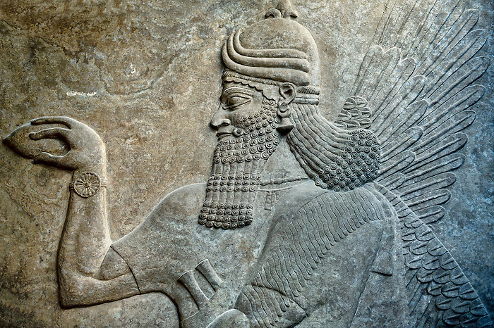 Assyrian relief sculpture panel  of a protective spirits,  from Nimrud, Iraq.  The spirit is holding a symbolic fir cone and is sprinkling holy water. 865-860 B.C North West Palace, Room G, door e, panel 1.  British Museum Assyrian  Archaeological exhibit  ref WA 124586
