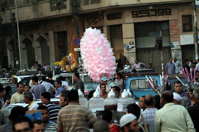 An Egyptian  sells sweets during a demonstration against Egyptian presidential candidate Ahmed Shafiq in Tahrir Square decrying the result of the first round of voting in the Egyptian presidential election in Cairo, Egypt, Friday, June 1, 2012. Several hundred protesters rallied Friday in Cairo's Tahrir Square, the birthplace of the Egyptian uprising. Photo by Ashraf Amra