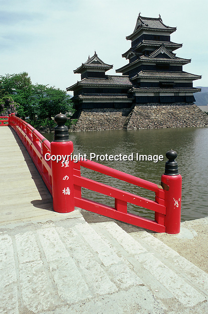 The red bridge over the moat makes a fine contrast with the dark stones and timbers of Matsumoto Castle. The castle was built in the late 16th century and has the oldest five-tiered keep in Japan.