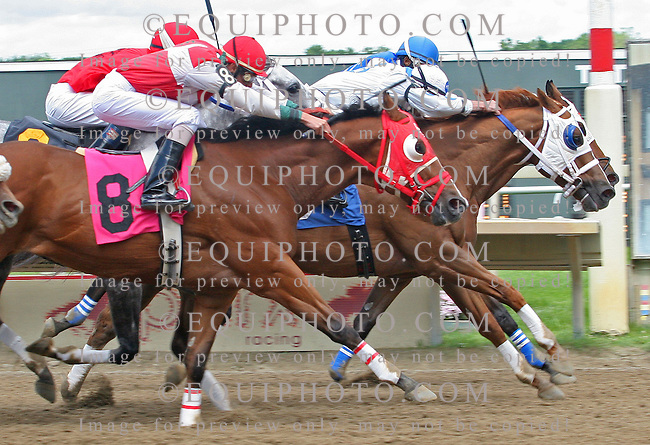 Mine For Love #3 with Josue Arce (white silks) wins the 7th race at Parx Racing in Bensalem, Pennsylvania June 4, 2012.  Secondthat Emotion #2 with Kennel Pellot (inside) second place and Big City Deputy #8 with Roberto Rosado third place.  Photo By Barbara Weidl/EQUI-PHOTO