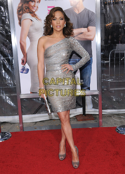"JENNIFER LOPEZ.at the CBS Films' L.A. Premiere of ""The Back-Up Plan"" held at The Village Theatre in Westwood, California, USA, April 21st, 2010..arrivals full length sleeve one shoulder silver sheer shimmery shiny dress clutch bag peep toe shoes beige hand on hip .CAP/RKE/DVS.©DVS/RockinExposures/Capital Pictures."
