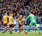 Curtis Main stuffs the ball up his shirt as he celebrates scoring Motherwell's third goal