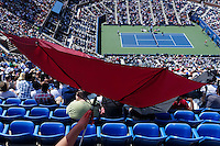 People watch the game of Novak Djokovic of Serbia against  Kei Nishikori of Japan during men semifinal match at the US Open 2014 tennis tournament in the USTA Billie Jean King National Center, New York.  09.05.2014. VIEWpress
