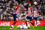 Jose Maria Gimenez of Atletico de Madrid (L) gestures after fighting for the ball with Toni Kroos of Real Madrid (R) during their La Liga  2018-19 match between Real Madrid CF and Atletico de Madrid at Santiago Bernabeu on September 29 2018 in Madrid, Spain. Photo by Diego Souto / Power Sport Images