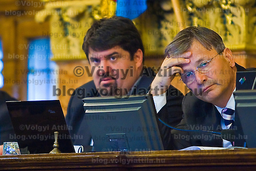 Mayor Gabor Demszky works during the session of the Budapest capital assembly.