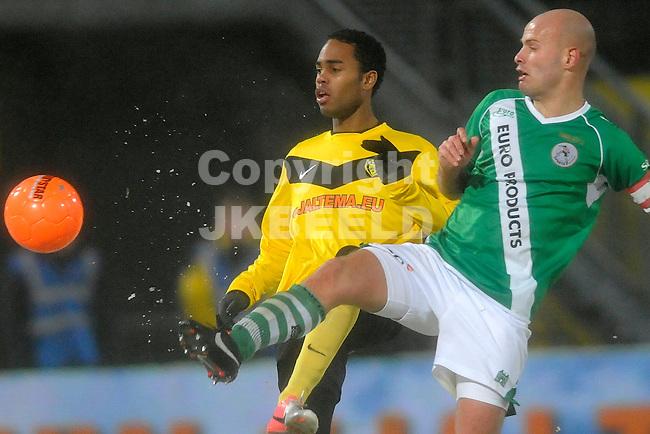 VEENDAM - Voetbal, SC Veendam - Sparta, Gjaltema stadion, seizoen 2012-2013, 21-12-2012 SC Veendam speler Boy Deul met Sparta speler Steef Nieuwendaal