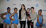 Nicole & Alana Feld - holding Piper Straus with skaters at Skating with the Stars - a benefit gala for Figure Skating in Harlem in its 17th year is celebrated with many US, World and Olympic Skaters honoring Michelle Kwan and Jeff Treedy on April 7, 2014 at Trump Rink, Central Park, New York City, New York. (Photo by Sue Coflin/Max Photos)