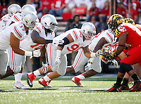 Ohio State Buckeyes defensive lineman Tommy Schutt (90) comes off the line of scrimmage during the Buckeyes' 52-24 win over the Maryland Terrapins in the NCAA football game at Byrd Stadium in College Park, Maryland on Oct. 4, 2014. (Adam Cairns / The Columbus Dispatch)