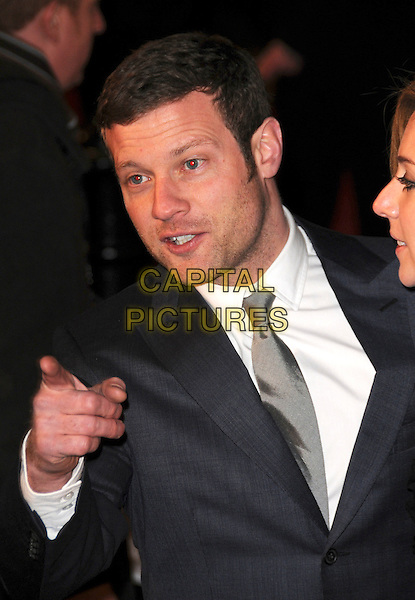 "DERMOT O'LEARY .At the UK Film Premiere of ""Revolutionary Road"" at the Odeon Leicester Square, London, England, January 18th 2009..half length blue suit grey gray tie hand finger pointing .CAP/CAS.©Bob Cass/Capital Pictures"