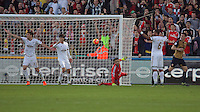 Lukasz Fabianski of Swansea (C) protests to the referee while Laurent Koscielny of Arsenal (R) celebrates his goal during the Barclays Premier League match between Swansea City and Arsenal at the Liberty Stadium, Swansea on October 31st 2015