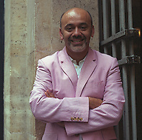 A portrait of the shoe designer Christian Louboutin